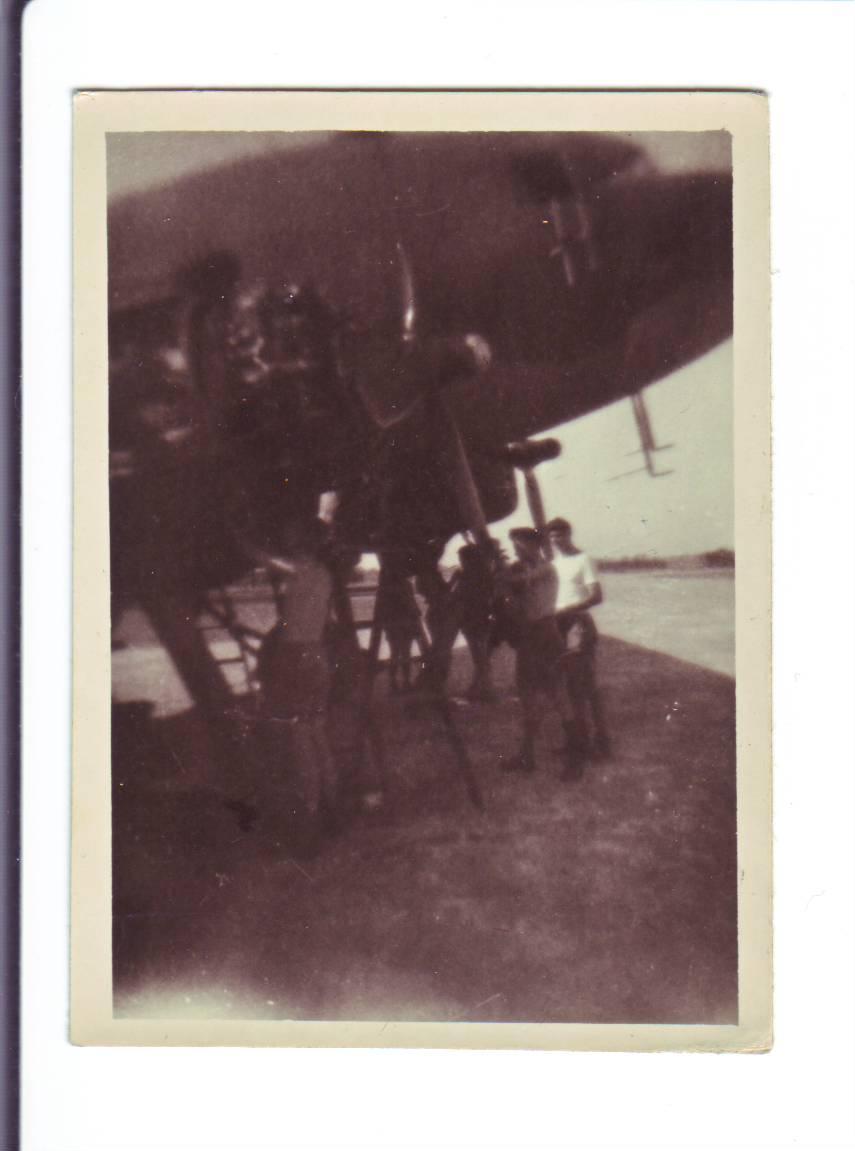 Photo #18 Several Airmen Working under Airplane