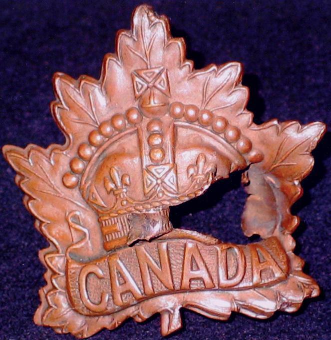 McLurg's badge, damaged by bullet